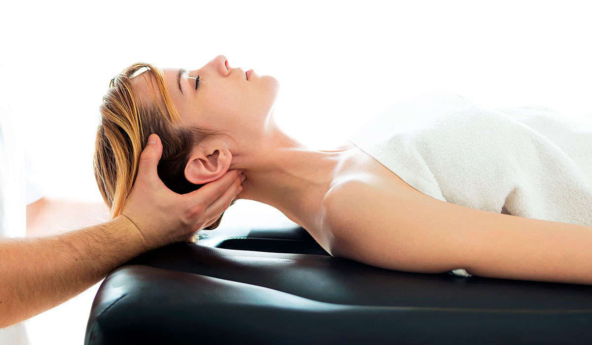 physiotherapist-doing-a-neck-treatment-to-woman